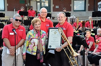 Paul Addison receives an award for serving as Webmaster for the Lafayette Citizens Band.