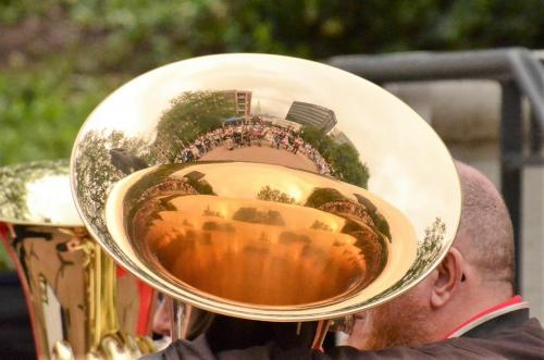 Audience reflected in a tuba bell