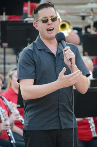 "Dustin Hopkins, guest soloist, sings ""New York, New York"""